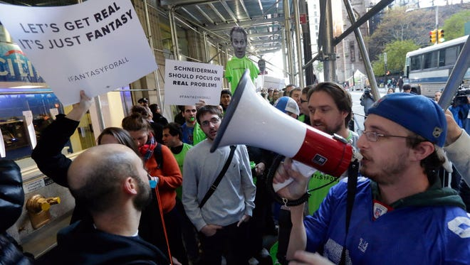 Fantasy sports fans demonstrate outside the Financial District offices of New York state Attorney General Eric Schneiderman in New York on Nov. 13, 2015. The state is battling fantasy companies FanDuel and DraftKings over the legality of daily fantasy games in the New York.