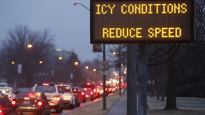 Icy conditions backed up cars on National Avenue Wednesday afternoon.