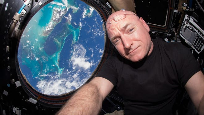 Is Scott Kelly experiencing zero gravity aboard the ISS in this file photo? Well, let's not spoil it for you.