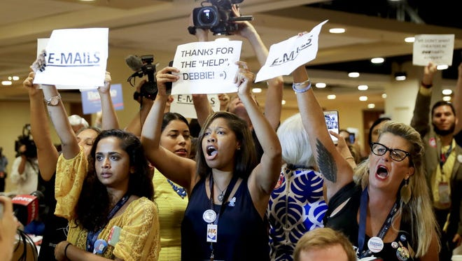 Protesters yell as the Democratic National Committee's chairwoman, Rep.Debbie Wasserman Schultz, D-Fla., arrives for a Florida delegation breakfast, Monday, July 25, 2016, in Philadelphia, during the first day of the Democratic National Convention.