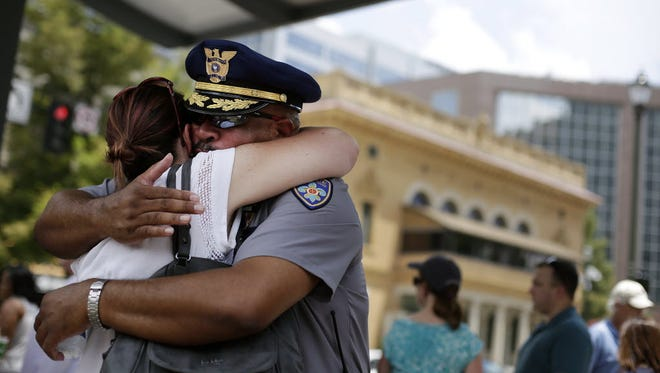 A police officer receives a hug during a prayer vigil in Baton Rouge on July 21, 2016.
