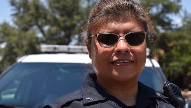 Priscilla Massey, an officer with the San Angelo Police Department, was driving on a regular patrol when she saw a fire outside a house in the 3800 block of Wild Rye Trail and got out to help extinguish it Wednesday, June 6, 2018.