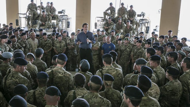 Prime Minister David Cameron addresses british troops on Oct. 3 in Camp Bastion, Afghanistan.