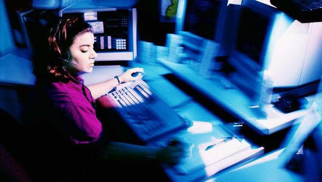 Woman working at dispatch terminal.