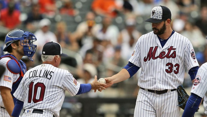 New York Mets manager Terry Collins pulls pitcher Matt Harvey during the fourth inning of Monday's game against the Miami Marlins at Citi Field. The Mets put Harvey on the disabled list on Wednesday.