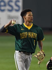 Bishop Manogue's Josh Rolling throws the ball in after