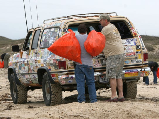 The Billy Sandifer Big Shell Beach Cleanup begins at