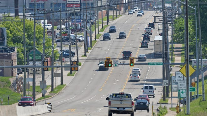 West 12th Street in Erie, shown looking east from Greengarden Road, is shown on Friday. The Pennsylvania Department of Transportation will improve signals and crossing controls along a six-mile stretch of the road, between Interstate 79 and Wayne Street, in 2021.
