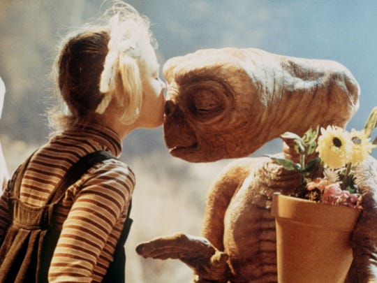 "Gertie (Drew Barrymore) smooches E.T. in a classic scene from ""E.T. the Extra-Terrestrial."""