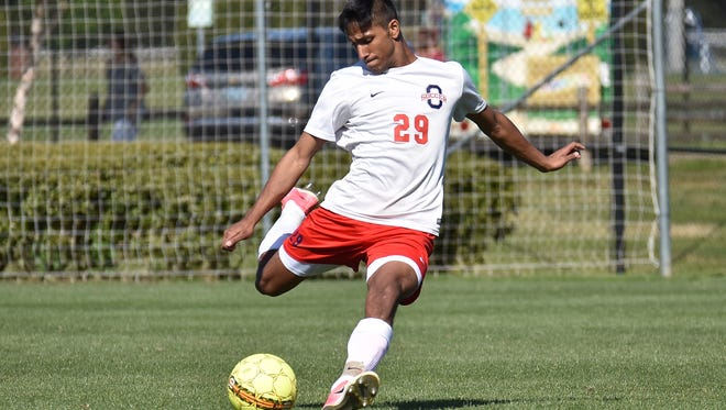 Oakland senior Noor Lalani kicks the ball during Sunday's 2-1 win over Central Magnet.
