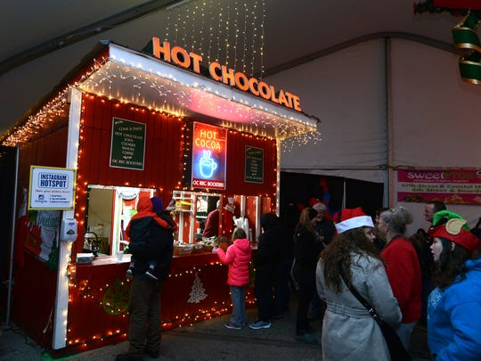 After riding the tram, cold visitors line up for hot chocolate at 2014's Winterfest of Lights at Northside Park in Ocean City.