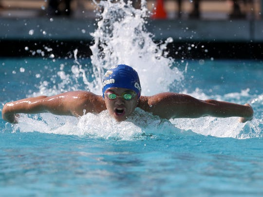 American Christian Academy's  Alex Aung competes in the men's 100 yard butterfly Wednesday at West Valley High School.