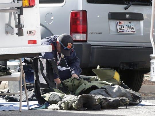 El Paso Police Department Bomb Squad members prepare