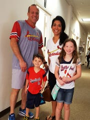Jeff and Sherry Ragland with their two children, Andrew and Avery, from Saint Louis enjoyed dressing up for the special spring training celebration while spending a week with Jeff's parents.