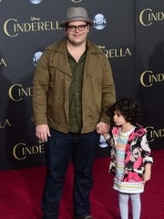 Actor Josh Gad and his daughter pose on arrival for the World Premiere of Disney's 'Cinderella' in Hollywood, California on March 1, 2015.