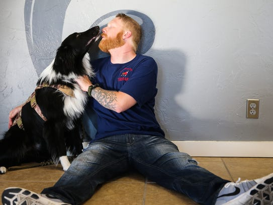 Matthew Ledbetter hangs out with his service dog, Sergeant,