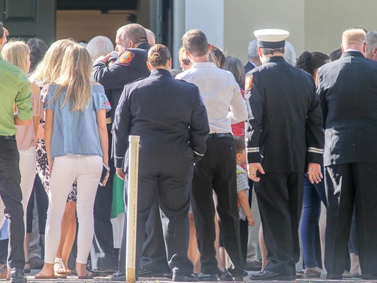 Wilmington firefighters gather for a memorial mass