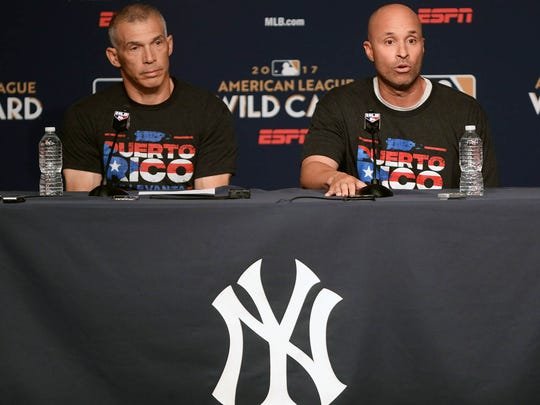 Joe Girardi entered the press conference with Third
