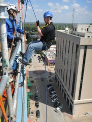 Scott Cook of KFDX begins his rappell off the roof