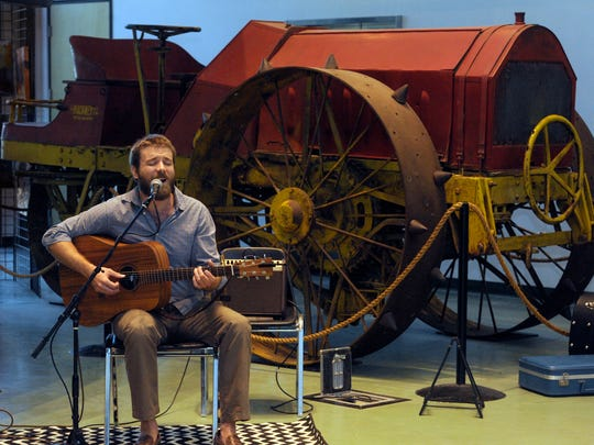 """Andrew Kenefick, pictured, performs his song, """"Highway"""" during """"History in the Making,"""" a collaboration of the Tulare County Museum and the Arts Consortium Saturday at the Tulare County Museum of Farm Labor and Agriculture located in Mooney Grove Park in Visalia."""