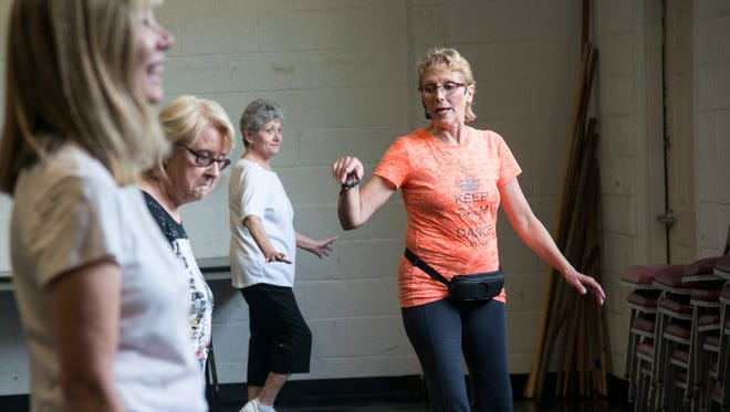 Cindy Hady keeps the tone light and fun at the beginning contemporary line dancing classes she teaches at the Carver Center.