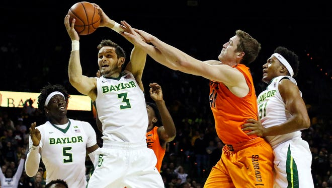 Baylor guard Jake Lindsey grabs a rebound against Oklahoma State.
