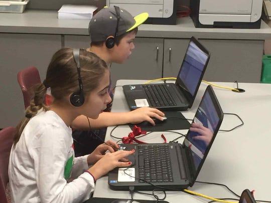 Three Bridges School third graders Isabella Durka and Karsten Schmey participate in the Hour of Code