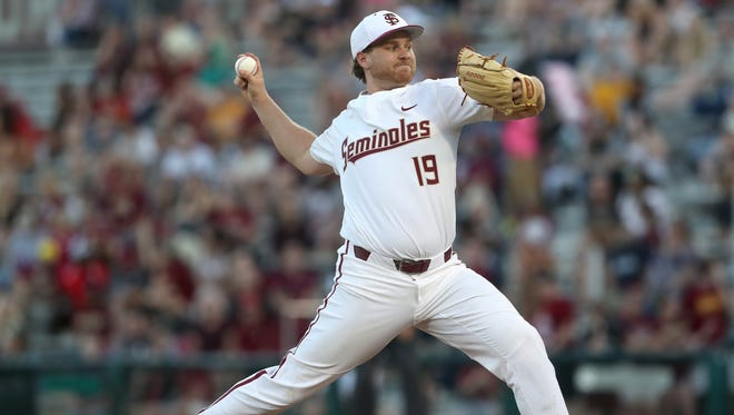 FSU's Andrew Karp pitches Xavier on opening day at Dick Howser Stadium on Friday, Feb. 16, 2018.