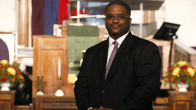 Rev. Julius McAllister stands in front of Bethel AME Church's main worship room.