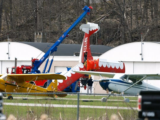 A two-seat Bellanca CH7A that crash landed in the middle of the 119-acre Lake Aeroflex at Kittatiinny Valley State Park on Monday morning is towed to a hanger after it was pulled out of the water. April 24, 2018 Andover Twp, NJ