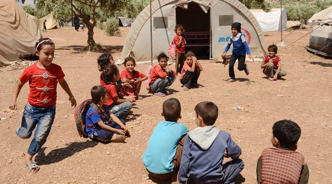 Children play in a refugee camp in Syria, on the border with Turkey, that is home to 20,000 internally displaced refugees.