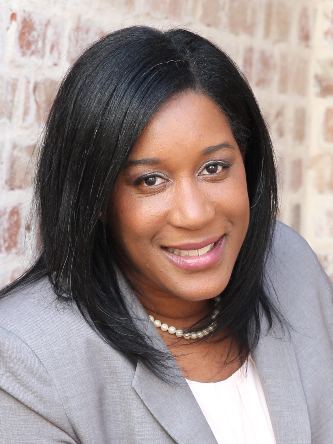 Natasha K. Magee-Woods