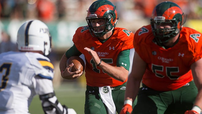 CSU quarterback Collin Hill carries the ball during a game against Northern Colorado at Hughes Stadium on Saturday.
