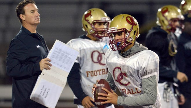 Tim Kirksey (far left) was the offensive coordinator at Oaks Christian under Jim Benkert, the longtime Westlake High head coach. Kirskey is now replacing Tony Henney, who replaced Benkert, as the head coach of the Westlake football program.