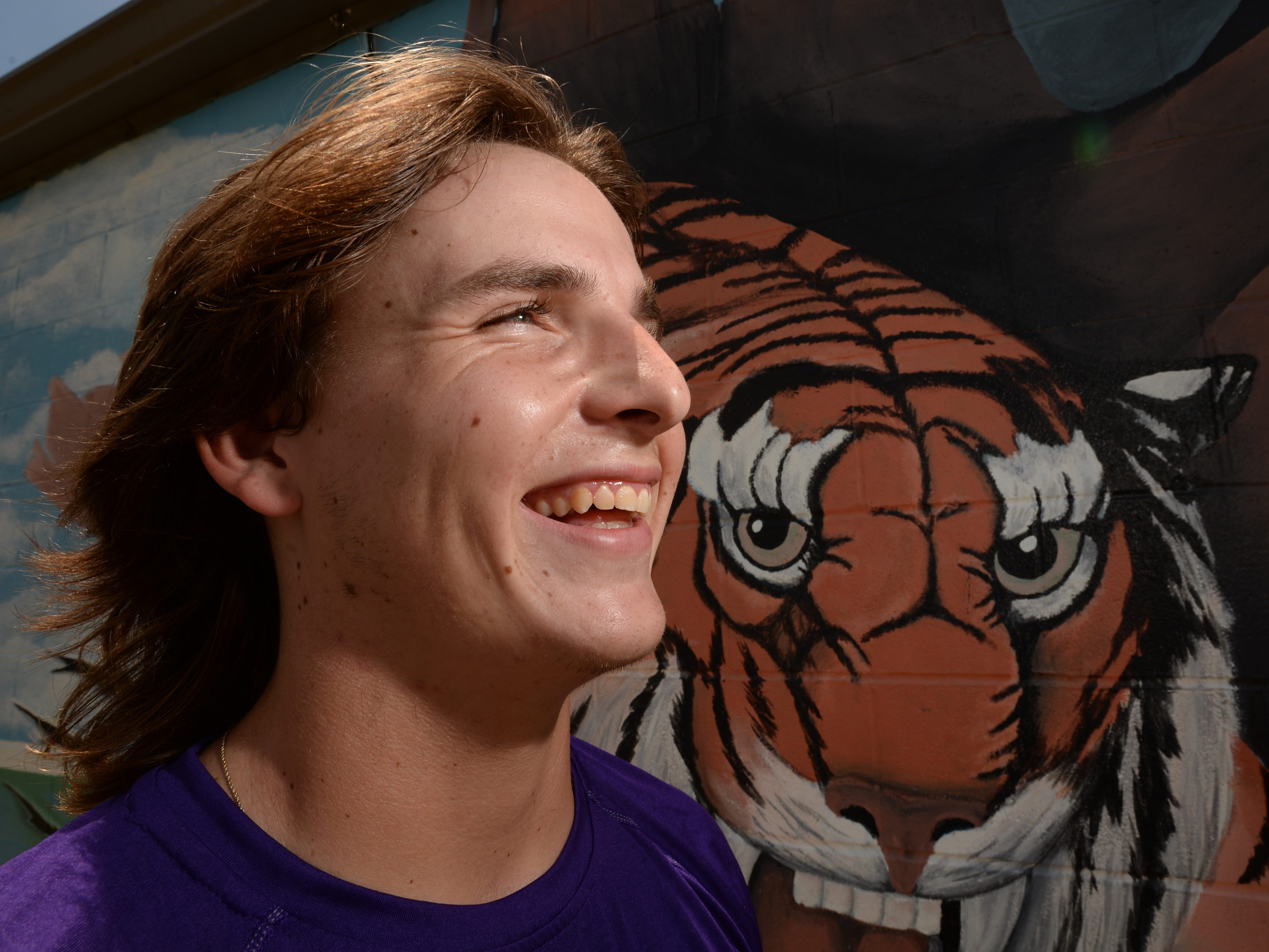 """A cool breeze blows through the hair of Benton's Jaret Gill who is attempting to bring back the """"mullet look""""."""