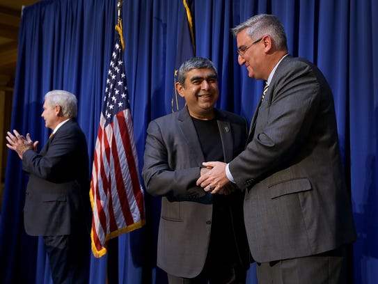 Governor Eric Holcomb,right, and Infosys CEO Dr. Vishal