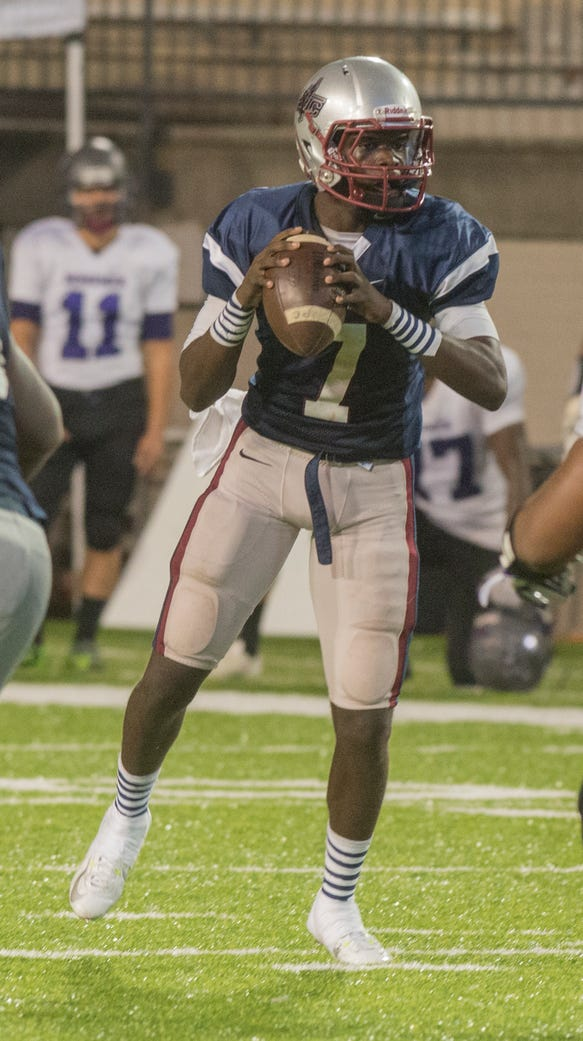 Park Crossing quarterback Malik Cunningham looks for