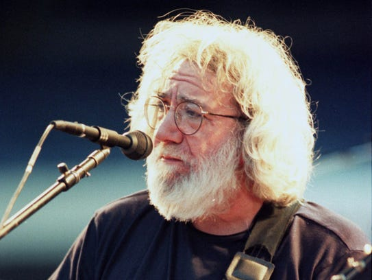 Jerry Garcia of The Grateful Dead plays at Giants Stadium