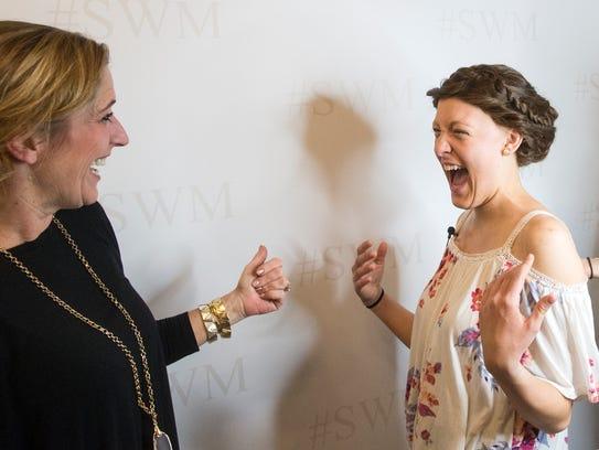 Alyssa White, right, and Dawn DeMario laugh while taking
