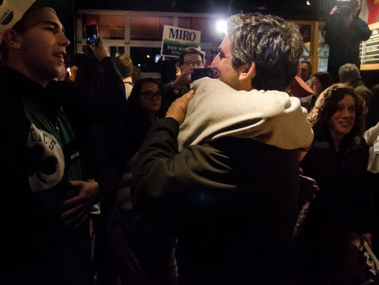Miro Weinberger is greeted by supporters at Nectar's