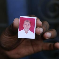 A relative holds a photograph of Mohammad Akhlaq, who was beaten to death on Sept. 28 in the village of Bisada, some 22 miles north-east of New Delhi, over rumors that he had eaten beef.