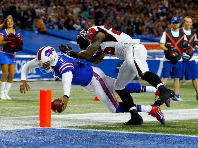 Buffalo Bills quarterback EJ Manuel (3) dives in for a touchdown while Atlanta Falcons strong safety William Moore (25) tries to make a tackle during the first half at the Rogers Center.