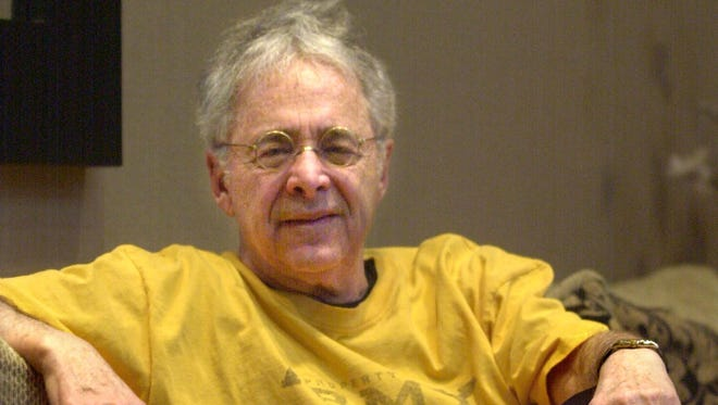 "In this Dec. 20, 2002 file photo, Chuck Barris, the man behind TV's ""The Dating Game,"" poses in the lobby of his apartment in New York. Game show impresario Barris has died at 87. Barris, the madcap producer of ""The Gong Show"" and ""The Dating Game,"" died of natural causes Tuesday afternoon, March 21, 2017, at his home in Palisades, New York. (AP Photo/Bebeto Matthews, File)"