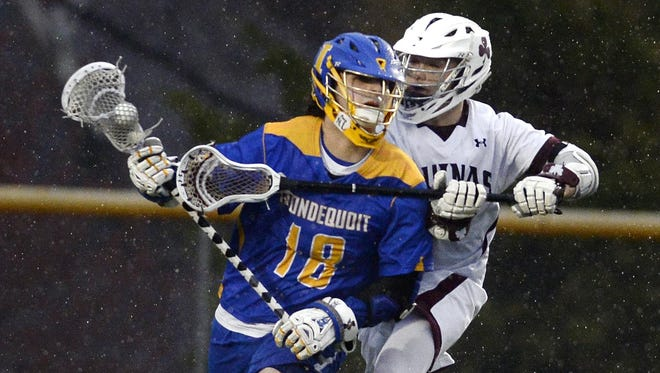 Irondequoit's Phil Barilla, left, is pursued by Aquinas' Cameron Cecere during a game at Aquinas on Thursday that was suspended because of lightning.