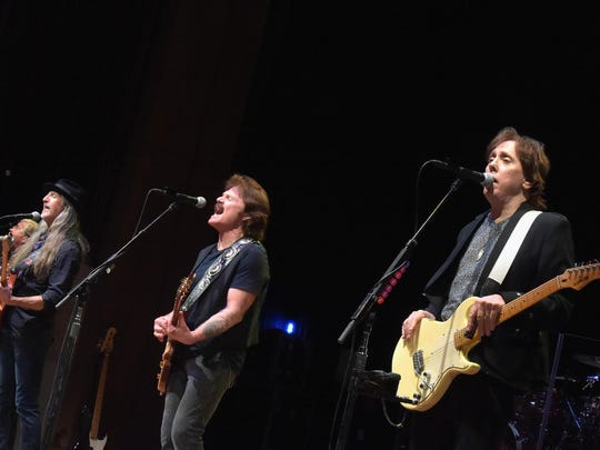 (L-R) Patrick Simmons, Tom Johnston and John McFee of The Doobie Brothers perform on stage at the Honors & Awards Ceremony on September 30, 2014 in Nashville, Tennessee.