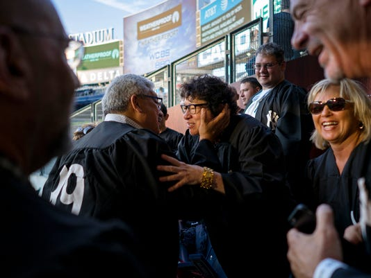 U.S. Supreme Court Justice Sonia Sotomayor, center, is greeted as she stands with family and friends just before the Boston Red Sox played the New York Yankees in a baseball game Thursday, Aug. 31, 2017, in New York. (AP Photo/Craig Ruttle)