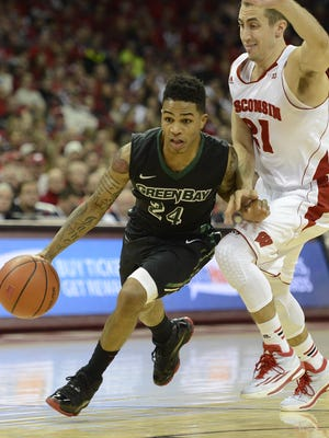 UW-Green Bay's Keifer Sykes (24) drives past Wisconsin's Josh Gasser (21) in the second half during Wednesday night's game at the Kohl Center in Madison.
