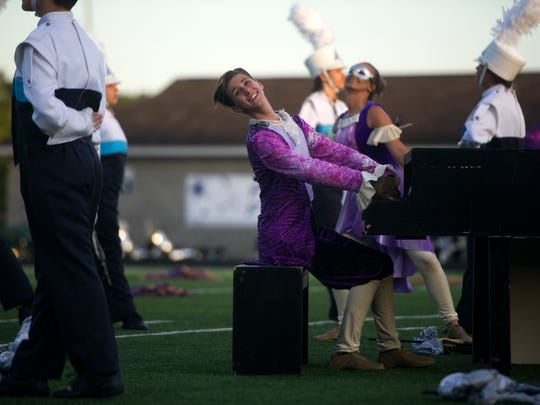 A member of the Hardin Valley marching band plays the keyboard on the field during the Knox County Band Exhibition held at Farragut High School Thursday, Oct. 5, 2017.