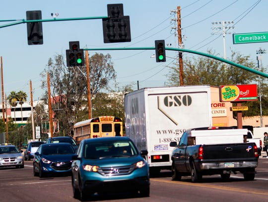 Cars pass through the intersection of 35th Avenue and