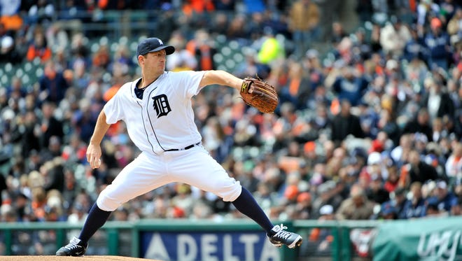 Detroit Tigers starter Jordan Zimmermann throws the first pitch of the game against the New York Yankees on Opening Day at Comerica Park in Detroit Friday, April 8, 2016. The Tigers won 4-0.